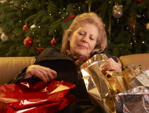 Woman asleep during the holidays.