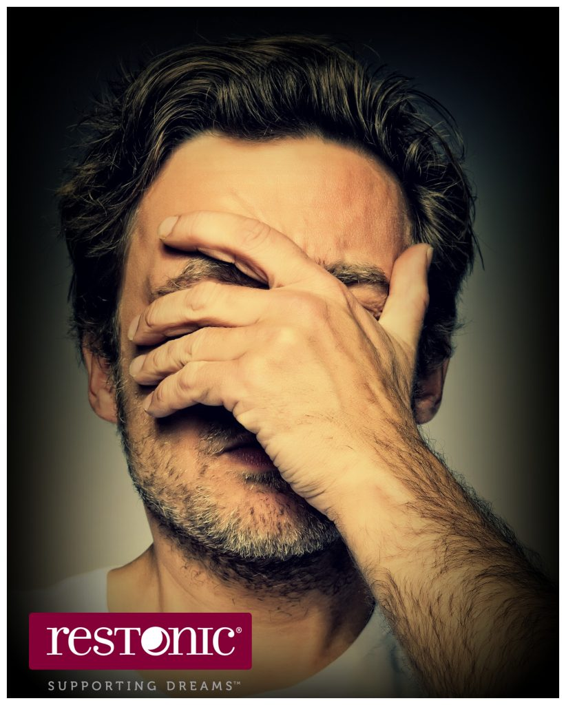 Man holding his face in anguish   Should I take sleeping pills?