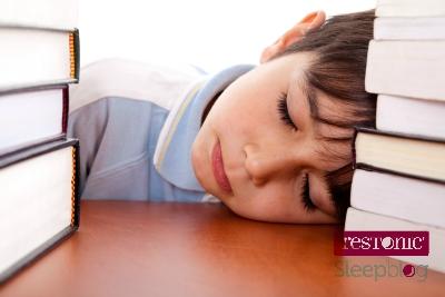student sleeping desk