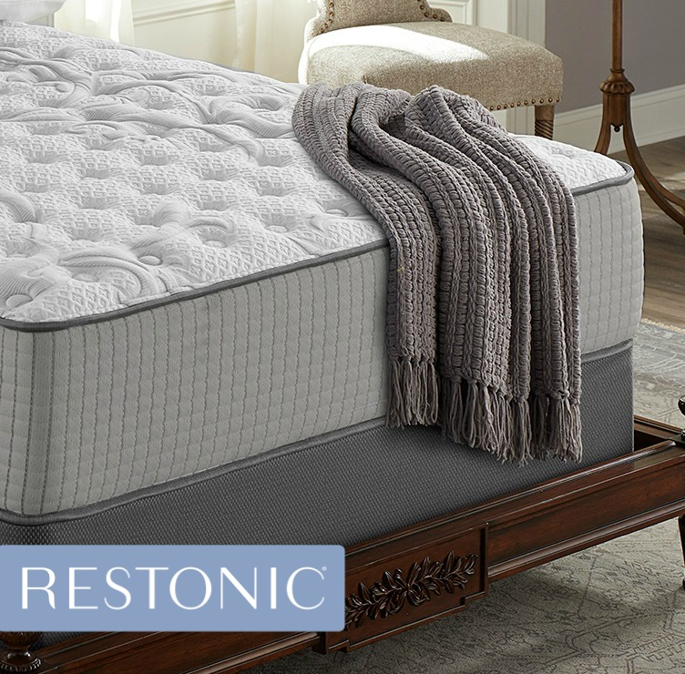 Electric blanket draped on a Restonic mattress let's you adjust the temperature to your personal comfort level.