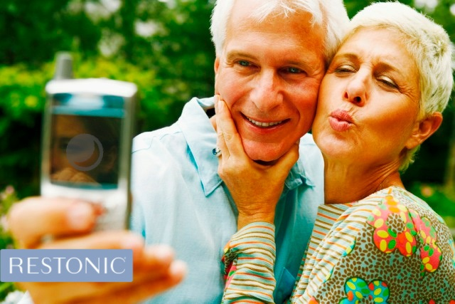 A couple taking a selfie and discussing ways to live longer which, starts with getting enough sleep.