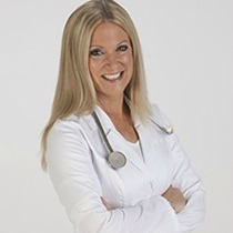 Profile image of Terry Cralle wearing a lab coat and a stethoscope around her neck.