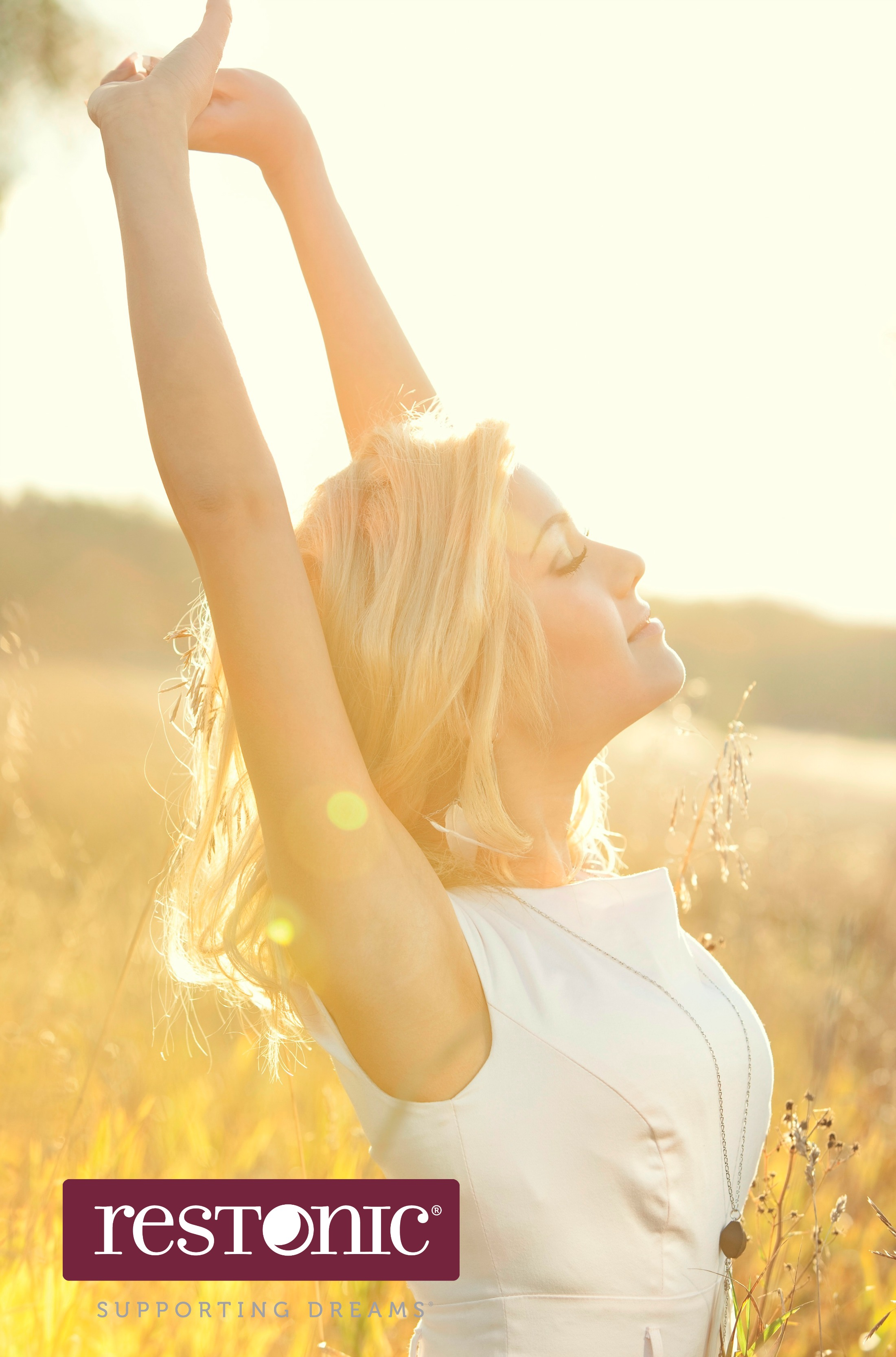 Woman stretching her arms amid sunlight as serotonin combats seasonal affective disorder.