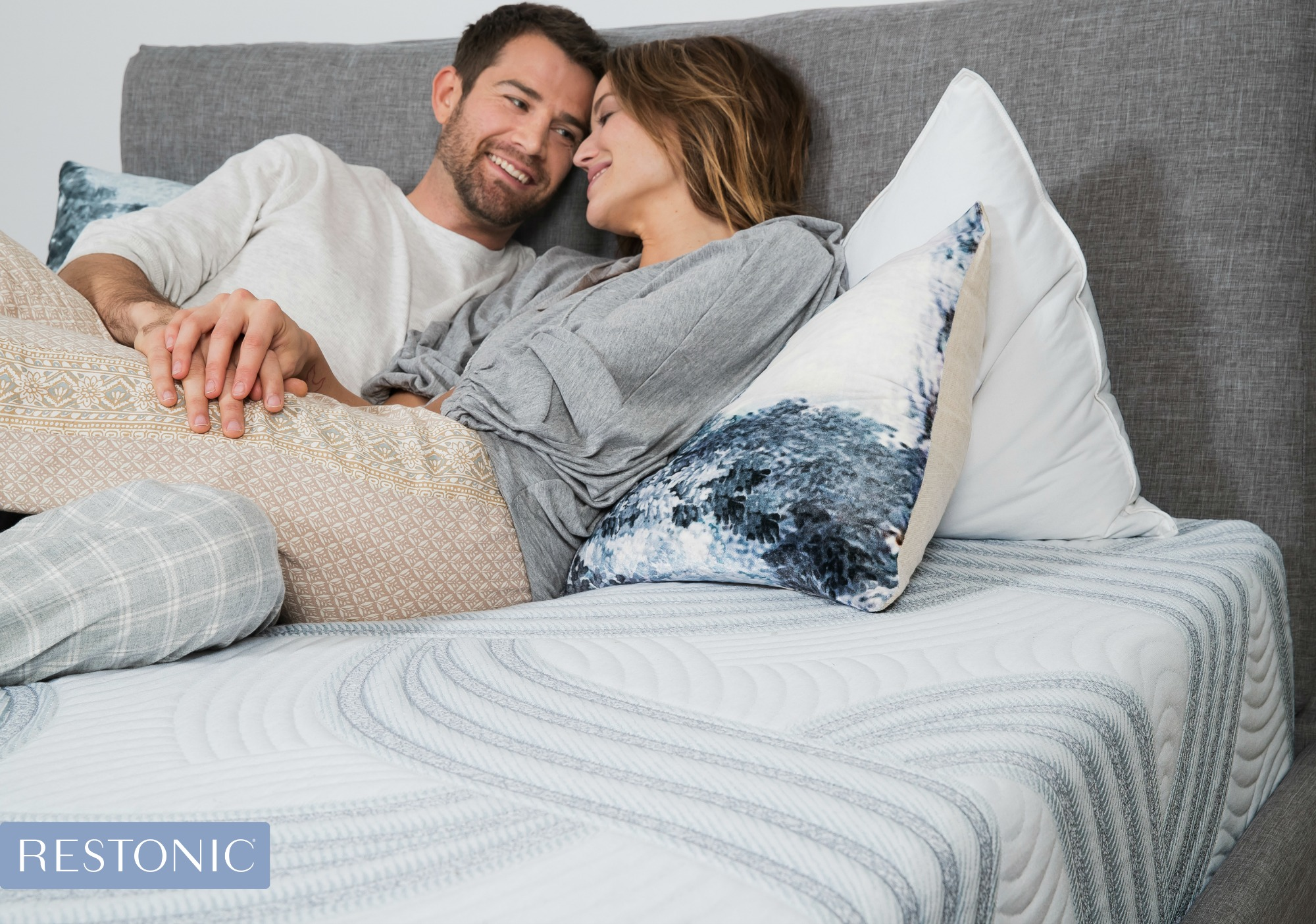 Couple enjoying a new mattress.