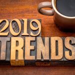 "Cup of coffee with ""2019 trends"" next to it."