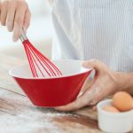 Fast & Easy Breakfast Recipe Hacks | Red whisk mixing eggs in a red bowl.
