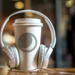 A coffee cup with headphones on it.