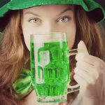 Women drinking green beer and wearing at St. Patrick
