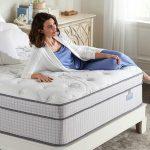 Woman relaxing on a Biltmore mattress.