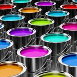 A number of paint cans with different colored paint inside each paint can.