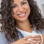 Woman posing with a coffee cup.