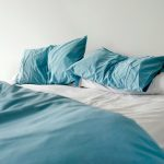 A disheveled looking bed. Should you make your bed?
